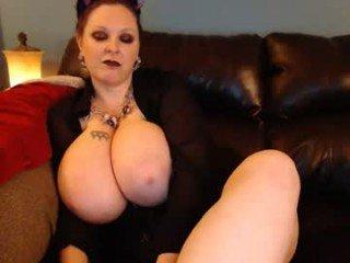 lillyth big tits cam girl pleasing her bushy cunt with a dildo